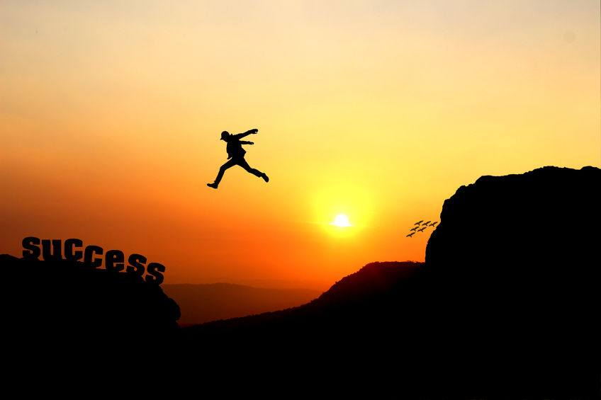 98959414 - silhouette of a man jumping over the cliff, jump go on to success